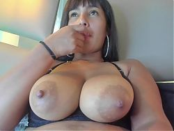 Busty Latina Elena sucks and licks her big nipple